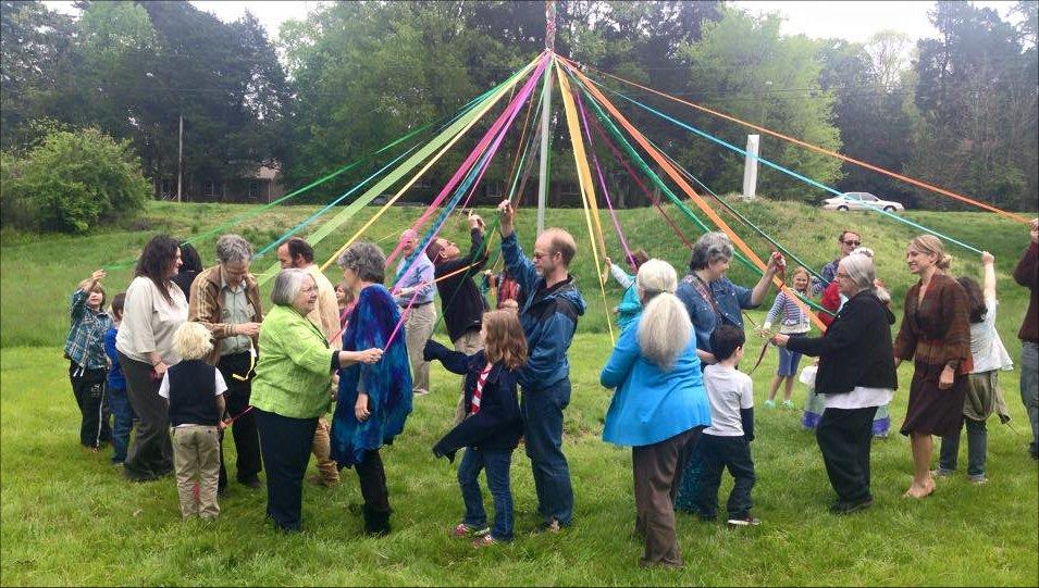 people circling the maypole